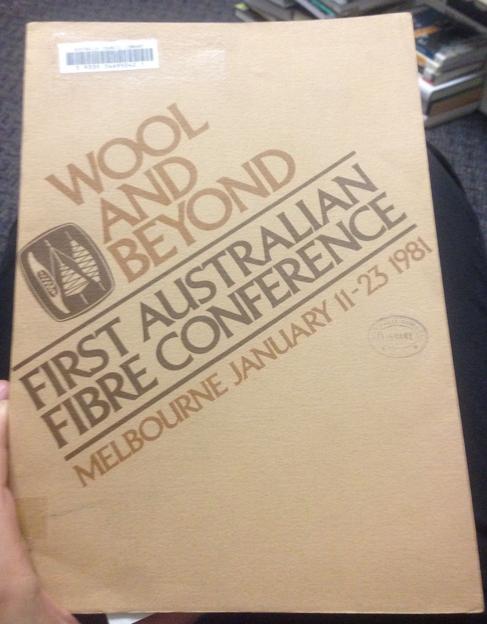 Photograph of the cover of Wool and Beyond: First Australian Fibre Conference: Melbourne January 11-23 1981 (1982)